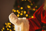 Hand of santa claus holding engagement ring