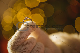 Close up of santa holding engagement ring