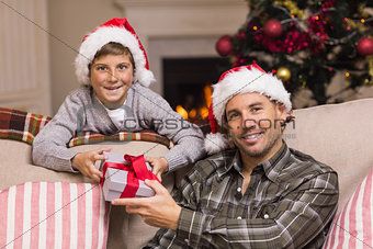 Portrait of smiling father and son at christmas