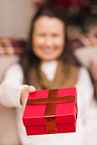 Brunette woman offering christmas gift