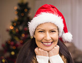 Portrait of a happy brunette in santa hat