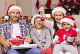 Happy family wearing santa hat on the couch