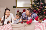 Peaceful family leaning on the couch