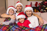 Festive family hugging under the cover