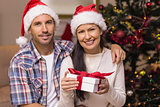 Festive couple holding christmas gifts