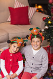 Smiling brother and sister in headband