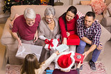 Happy family exchanging gifts at christmas