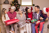 Festive family opening gifts at christmas