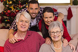 Smiling family posing at christmas