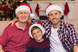 Smiling men of the family posing at christmas