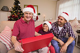 Smiling grandfather opening his gift