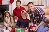 Portrait of smiling family celebrating christmas