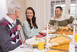 Cheerful family having christmas dinner together