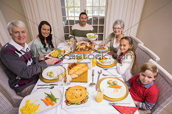 Three generation family during christmas dinner together