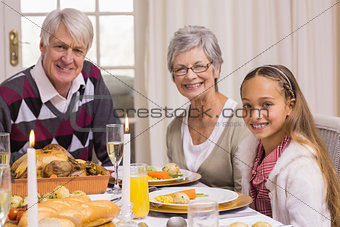 Portrait of grandparents and daughter during christmas dinner