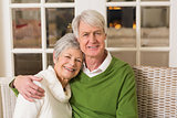 Portrait of smiling mature couple at table