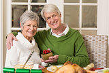 Senior couple holding a christmas present
