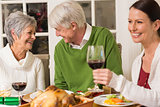 Senior couple laughing at christmas dinner