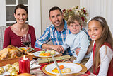 Portrait of smiling family during christmas dinner