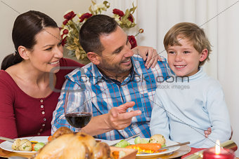 Portrait of parents and son at christmas dinner