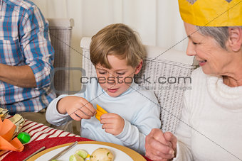 Portrait of grandmother and son in party hat