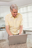 Senior man using his laptop