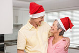 Senior couple wearing santa hats