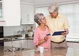 Senior couple shopping online with tablet pc