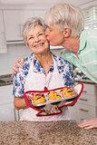 Senior man giving his wife a kiss