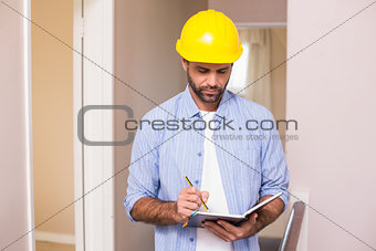 Casual architect reading his notes