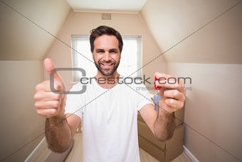Casual man showing his house key