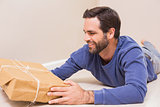 Happy man looking at package