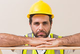 Stern construction worker looking at camera