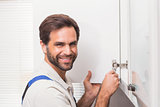 Handyman fixing the cupboard