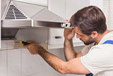 Handyman fixing the oven
