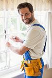 Handyman fixing a window