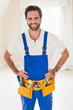 Handyman smiling at camera in tool belt