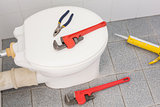 Plumbing tools on the toilet