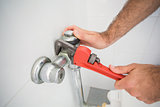 Plumber fixing tap with wrench
