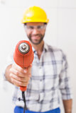 Construction worker holding power drill