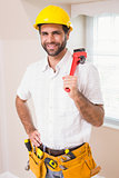 Handyman smiling at camera in tool belt