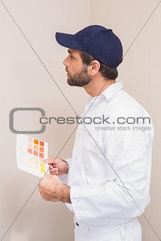 Painter holding a colour chart