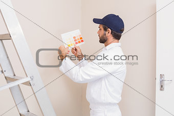 Painter holding a colour chart