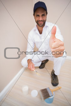 Painter showing thumbs up to camera