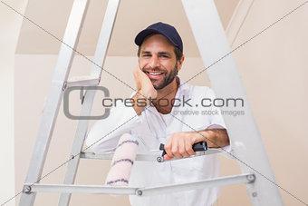 Painter smiling at the camera