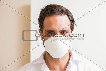 Carpenter wearing protective mask looking at camera