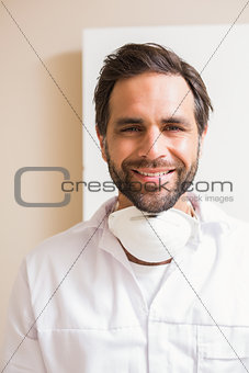 Carpenter wearing protective mask smiling at camera