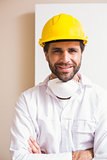 Carpenter wearing protective mask smiling at camera