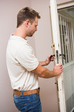 Handyman testing the door handle