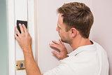 Man hand sanding the door before refinishing